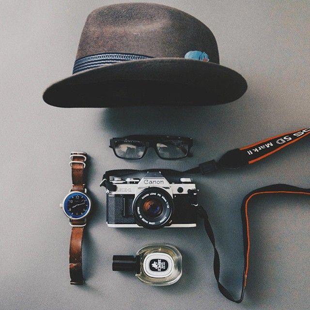 Man vs City. Essentials by @torontosaur, featuring the Nixon October. #regram #nixon #essentials - Nixon leather watch - Camera - Hat