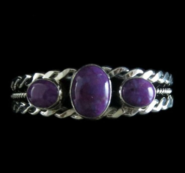 Sterling silver bracelet with 3 oval Magenta Turquoise stones set on a beautiful twisted wire silver cuff http://nativeamericanstuff.net/magenta_turquoise_jewelry.htm