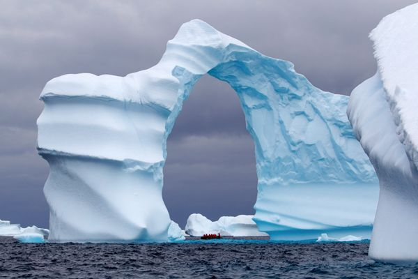 #Antarctica - Huge arch shaped Iceberg.