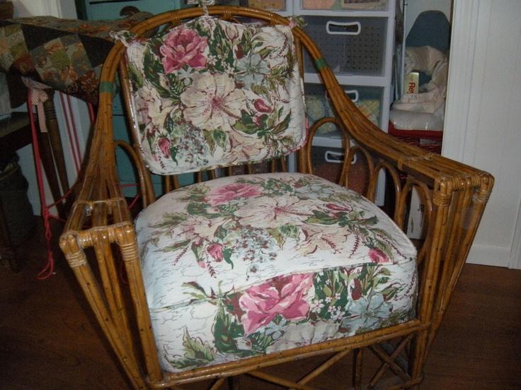 Ooohhhh - nice vintage rattan chair with barkcloth cushions...