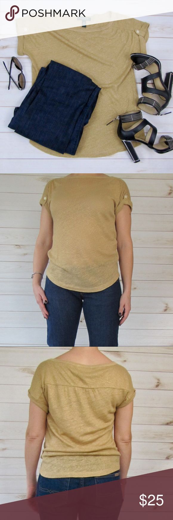 """Ralph Lauren short-sleeved metallic gold top Lauren Ralph Lauren short-sleeved crew-neck gold linen jersey top features roll-up sleeves with buttons. 100% linen fabric makes the piece breathable and easy to wear. So versatile--works equally well paired with jeans or as a shell under a suit.   Measurements are approximate, taken while garment is lying flat:  Bust (armpit to armpit) = 17""""  Length (shoulder to hem) = 21"""" Lauren Ralph Lauren Tops"""