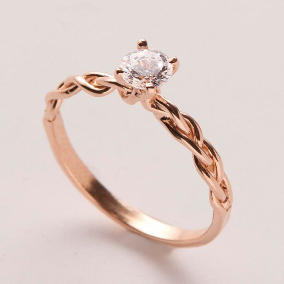 Rose gold, braided engagement ring. Comes with a wedding band too.