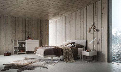 """Teo è un letto con struttura in legno dalle forme essenziali e moderne disponibile con due varianti di piattaforma. Il pannello testiera può essere """"vestito"""" da un cappuccio imbottito e trapuntato disponibile in tutti i rivestimenti a campionario. Dispone inoltre di una versione con contenitore nella piattaforma """"P18/P24/P22""""."""