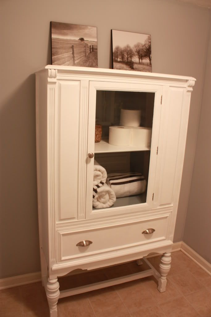 I want to re-do old furniture finds in white for a bathroom hutch like this!