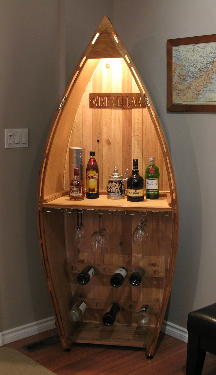 The boat bar  Cedar style canoe wine and liquor rack