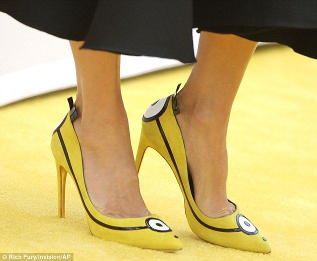 Creatures: The yellow shoes were decorated with big white eyes on the toes and on the heels