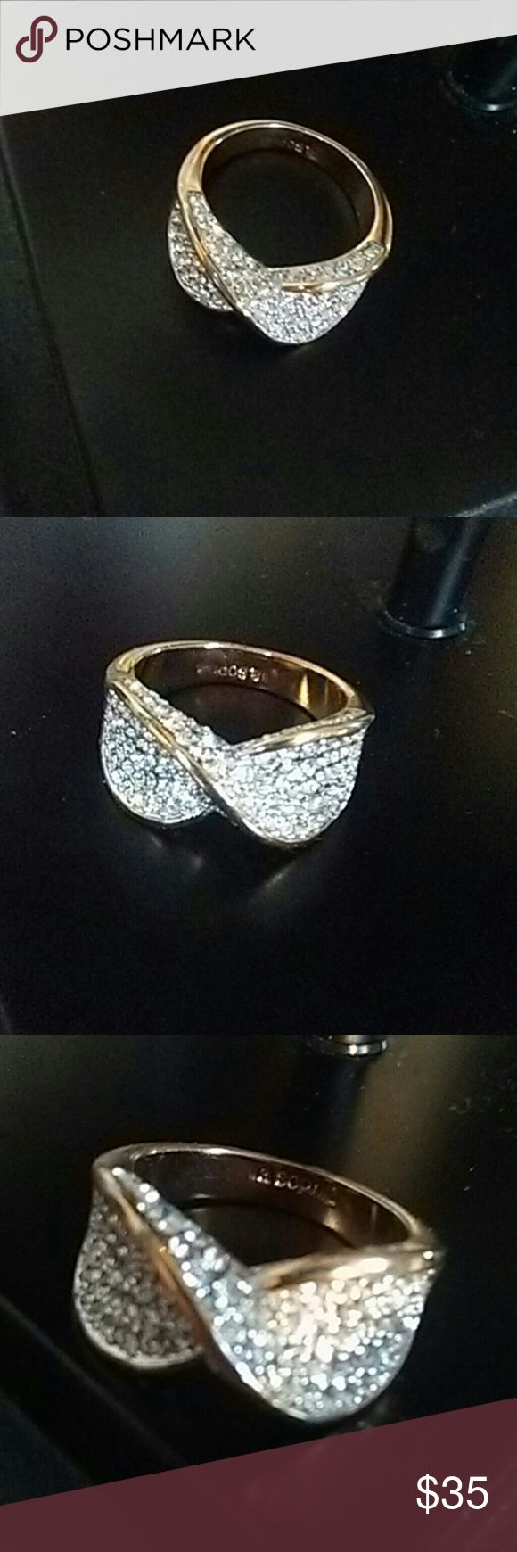Lia Sophia diamond encrusted cocktail ring Lia Sophia CZ and gold cocktail ring. Swirl design. Size 7. Brand New Condition. Beautiful!  Doesn't fit any of my fingers. This flawless ring is perfect for any occasion! Lia Sophia Jewelry Rings