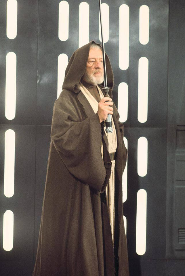 """Obi-Wan Kenobi on the Death Star with a pre-visual effects lightsaber. """"Who is the bigger fool? The fool or the fool who follows him?"""""""