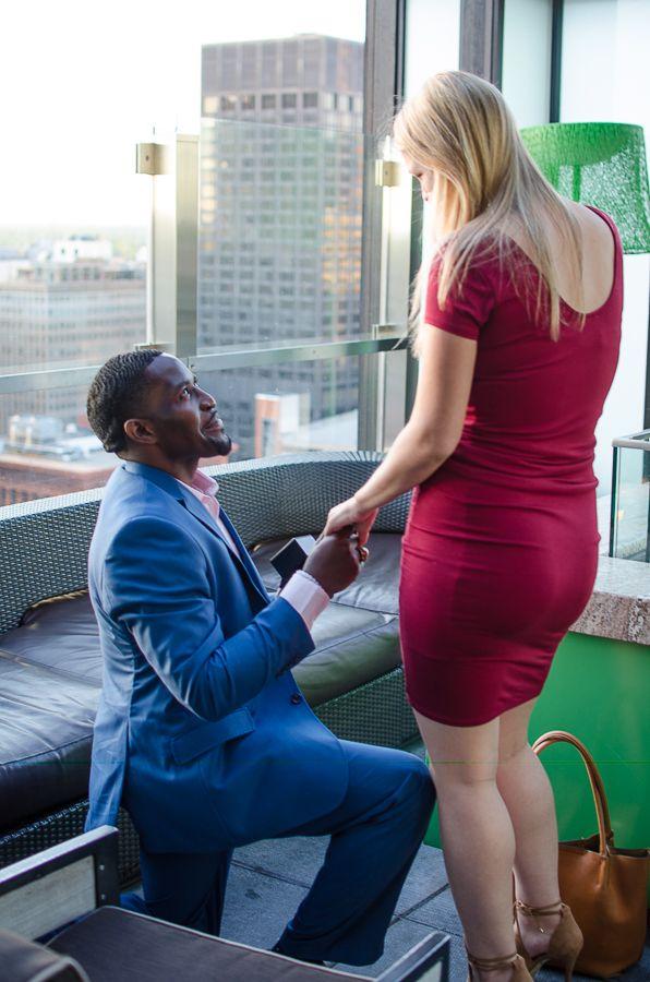 proposal photos . surprise proposal. engagement photos . rooftop proposal . rooftop engagement . biracial couple . sweet engagement photos Sweet Sarah Marie Photography | St. Louis Photographer