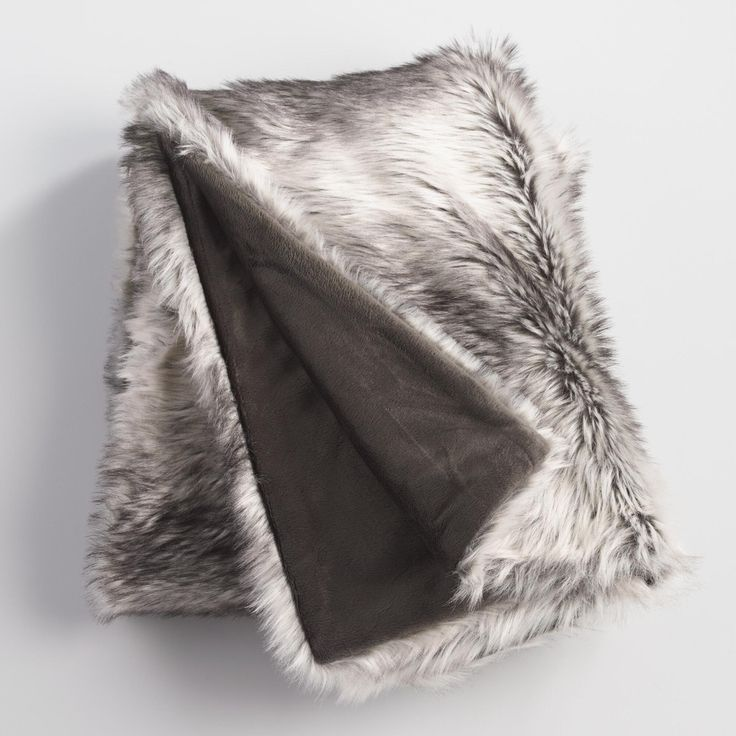 With a rich gray color that blends effortlessly with any decor, our faux fur throw lends luxury to your space at an irresistibly affordable price.