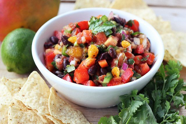 Mango Black Bean Salsa 1 mango, diced 1-2 tomatoes, diced 1 red bell pepper, diced 1 jalapeño, finely diced juice from 1 lime 1/4 cup fresh cilantro, roughly chipped 1/2 medium red onion, diced 1 cup cooked black beans 1/2 teaspoon cumin 1/2 teaspoon chili powder salt and pepper, to taste Add all of the ingredients to a medium bowl, stir/toss well to combine
