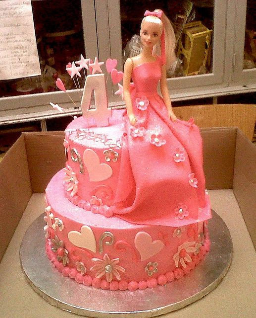 2-tier Wicked Chocolate cake iced in pink butter icing decorated with barbie in fondant dress, 3D #4, fondant hearts & daisies with silver accents by Charly's Bakery, via Flickr