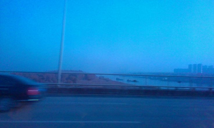 glimpsing of the Yangtze River as we go across the bridge is very long... the river is wider than this the part by the car is an island