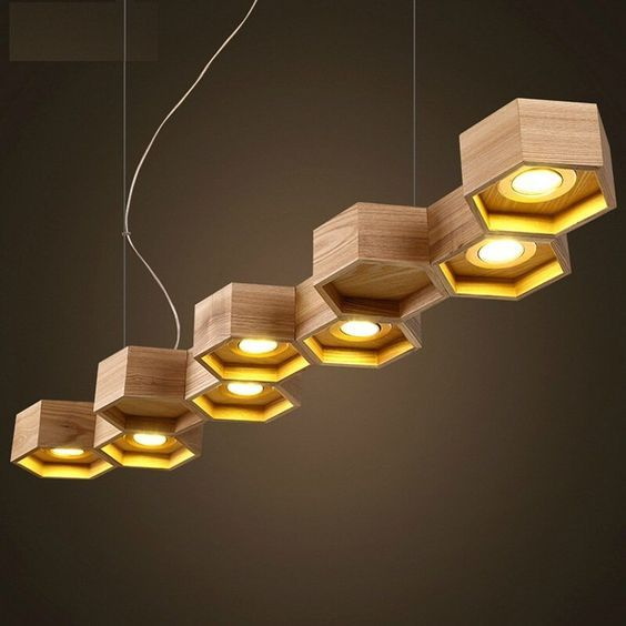 suspension bois design par Pilke Light en forme nid d'abeilles à 9 alvéoles hexagonales: