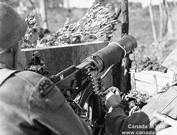 Ortona - An unidentified gunner of the Saskatoon Light Infantry (M.G.) laying down harrassing fire with a Vickers machine gun. January 7, 1944. Ortona, Italy (vicinity).