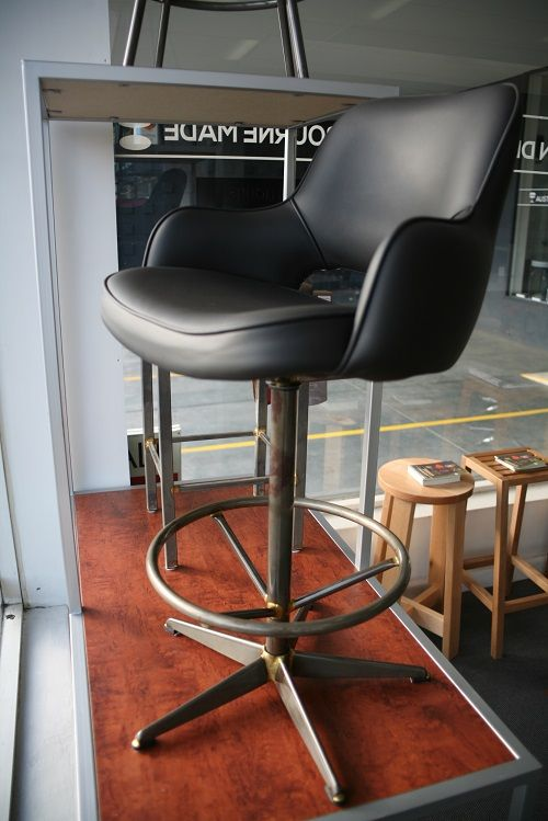Industrial bar / kitchen / counter stools. Raw finish base and black leather.