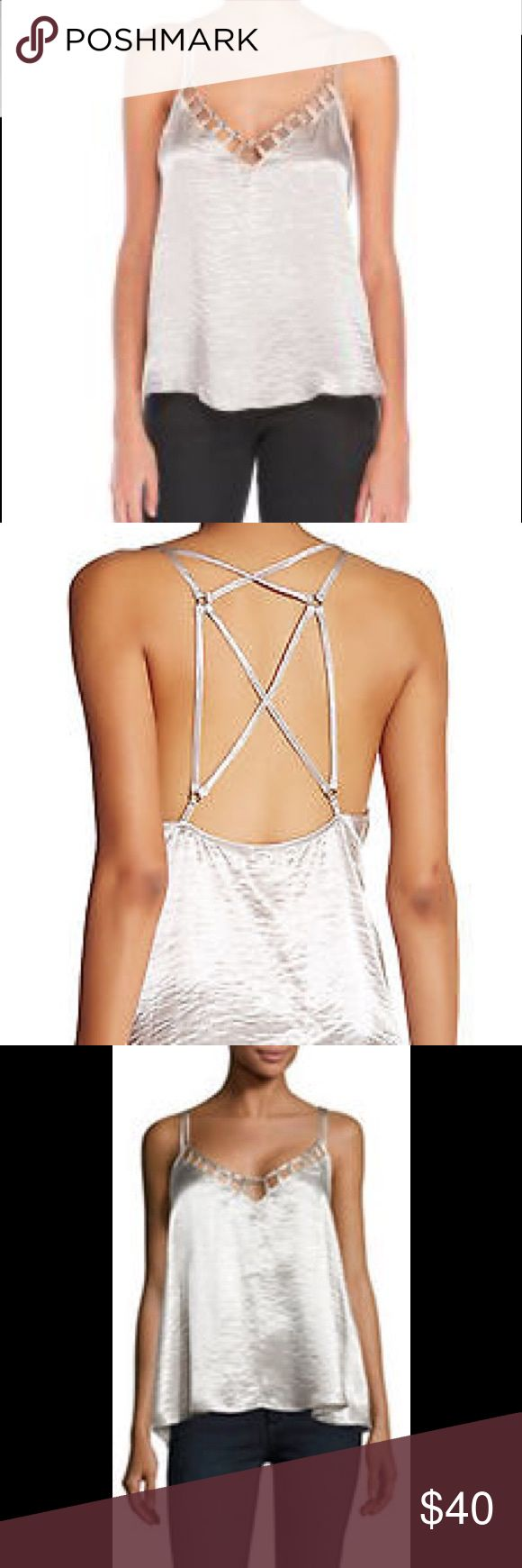 Free people metallic silver strappy tank top M New with tags free people tank top in silver metallic haze with a strappy back. Size medium and nice and flowy. Smoke and pet free home no trades Free People Tops Tank Tops