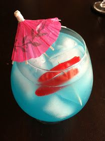 Shark Infested Waters Cocktail:  two parts Bacardi Zombie mix, 1 part 7-Up, 1 part Lemonade, 1 part Vodka and a splattering of swedish fish and a cocktail umbrella for looks.