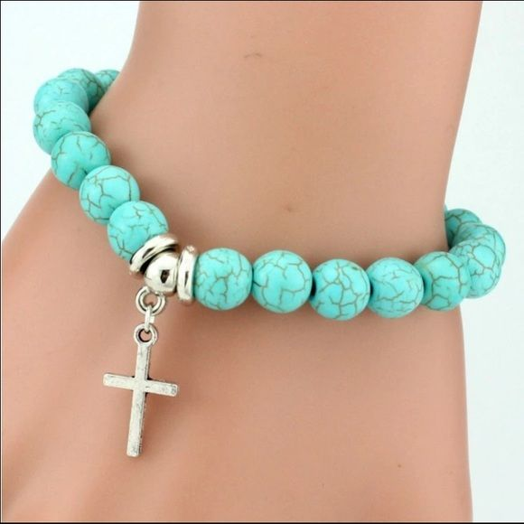 Beautiful beaded bracelet that has elastic stretch for any size wrists. Beads are green with Cross charm dangling