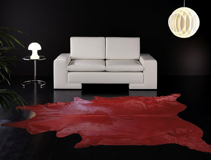 eCowhides.com - Red Dyed cowhide, $298.00 (http://www.ecowhides.com/red-dyed-cowhide-rugs/)