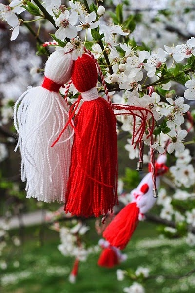 Baba Marta Day Celebration!        For my beautiful friend, Rada!  :)   Martenitsa, red and white tasselled strings, traditionally tied around the wrist in Bulgaria on 1 March, Baba Marta (Grandmother March day) in Bulgaria;  The martenitsa suggests the passing of winter and arrival of spring; martenitsa are traditionally worn until a stork, swallow, budding tree or another sign of spring is sighted. #Spring #Bulgaria