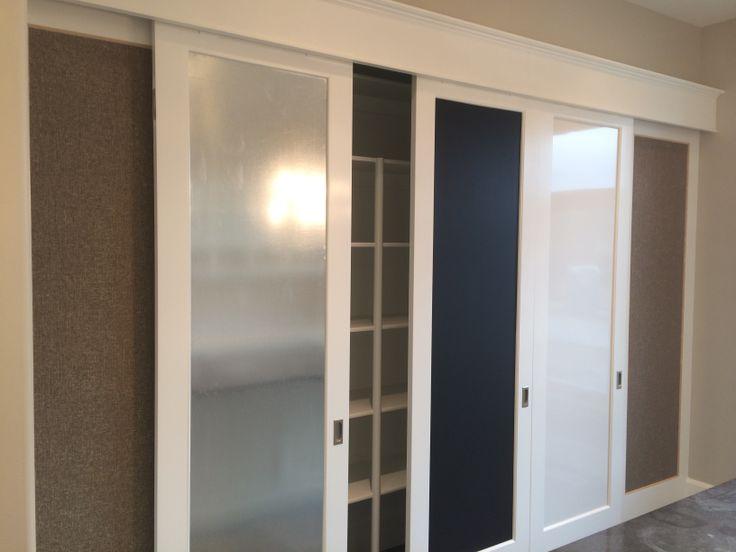 Hidden closet behind magnetic, chalk and dry erase boards. #mcewancustomhomes #utahbuilder #craftroom #closet