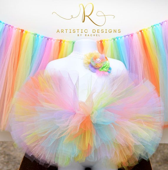 Tutu and Headband Set This sweet rainbow tutu is designed with 8 layers of soft tulle tied to a crochet waistband making this skirt is full and fluffy. It photographs beautifully for cake smash and birthday party sessions. Matching satin ribbon is woven through the waistband and tied in a pretty bow for an elegant touch. Set comes with an adorable matching headband as pictured above. Listing is for tutu and headband only. Banner sold separately. ♥ Size: Select from drop down menu. ♥ Waist...