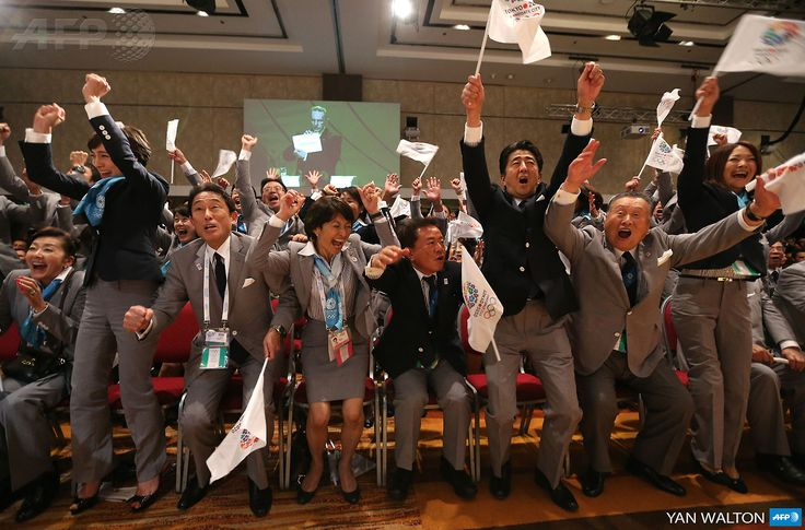 ARGENTINA, Buenos Aires: Japanese Prime Minister Shinzo Abe (3-R) celebrates alongside Tokyo 2020 delegation members after IOC president Jacques Rogge announced the Japanese capital to be the winner of the bid to host the 2020 Summer Olympic Games, during the 125th session of the International Olympic Committee (IOC), in Buenos Aires, on September 7, 2013. . AFP PHOTO / YAN WALTON