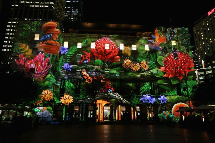 Vivid Sydney 2015: A festival of lighting artistry - The Customs House at Circular Quay is illuminated by the 'Enchanted Sydney' projected artwork.