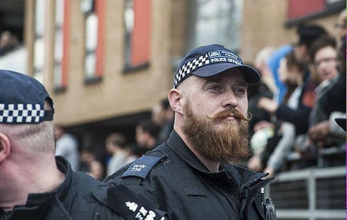 """Hipster Cop can handcuff me anytime! A Bearded """"Hipster Cop"""" From The Protests In London Has Become A Huge Meme"""