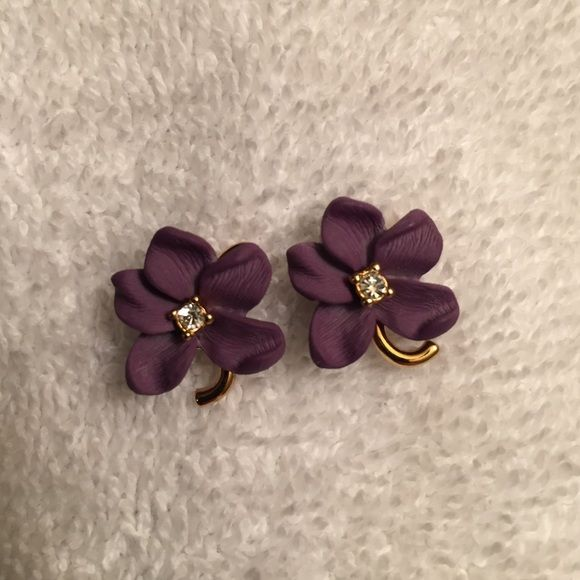 "Joan Rivers Purple Violet Flower Post Earrings Joan Rivers gold-tone purple violet flower post earrings with clear crystal accents. They are in excellent condition. No tarnish, or flaws of any kind. They look brand new & appear never worn at all! Each earring back is signed ""Joan Rivers"". Earrings measure: 7/16"" x 5/8"". More beautiful in person! So pretty!!! Joan Rivers Jewelry Earrings"