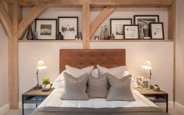 Our contemporary barn bedroom design is richly warmed by the bespoke tan leather buttoned headboard and given a stylish edge by these trendy metal side tables.