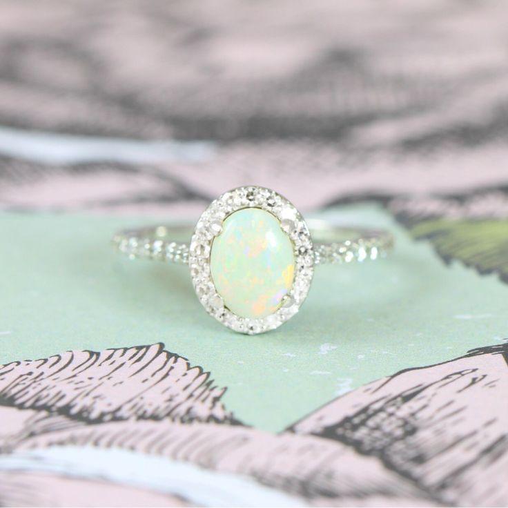 Opal and Diamond halo engagement ring in 14 carat white gold for her handmade ring UK by aardvarkjewellery on Etsy https://www.etsy.com/listing/513678325/opal-and-diamond-halo-engagement-ring-in
