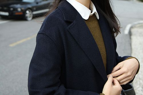 navy coat, olive sweater and ivory collar.