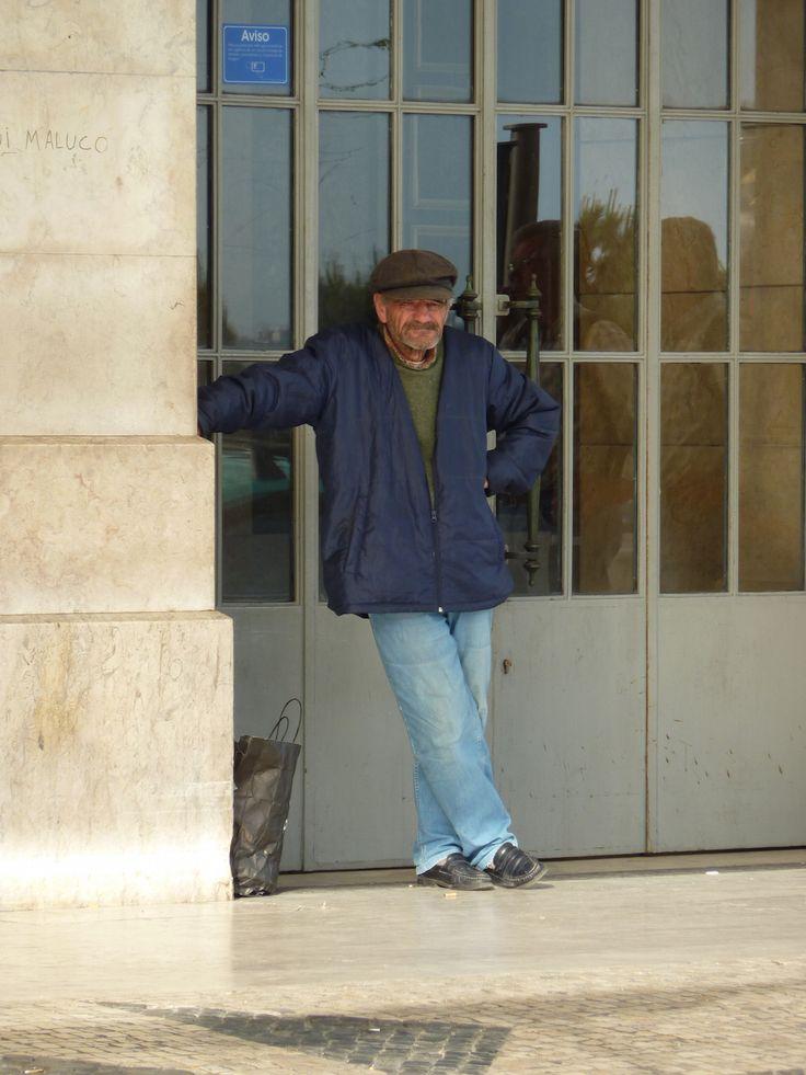 man outside train station in lisbon