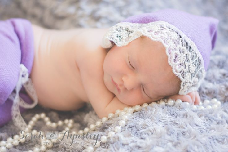 newborn baby girl in lace and pearls www.sarah-aynsleyphotography.com