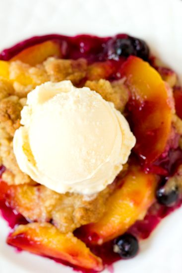Peach and Blueberry Crumble, warm, juicy and full of flavor. All you need is a scoop of vanilla ice cream and you have dessert perfection!