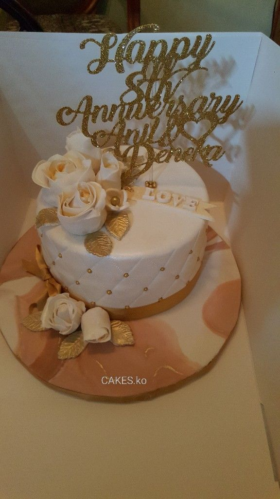 Did this gold and white Anniversary cake for a lovely couple .Click link to my business page for more of my work.