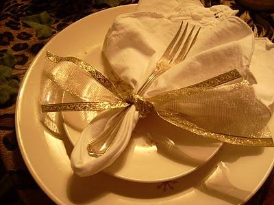 beautiful napkin fold and ribbon
