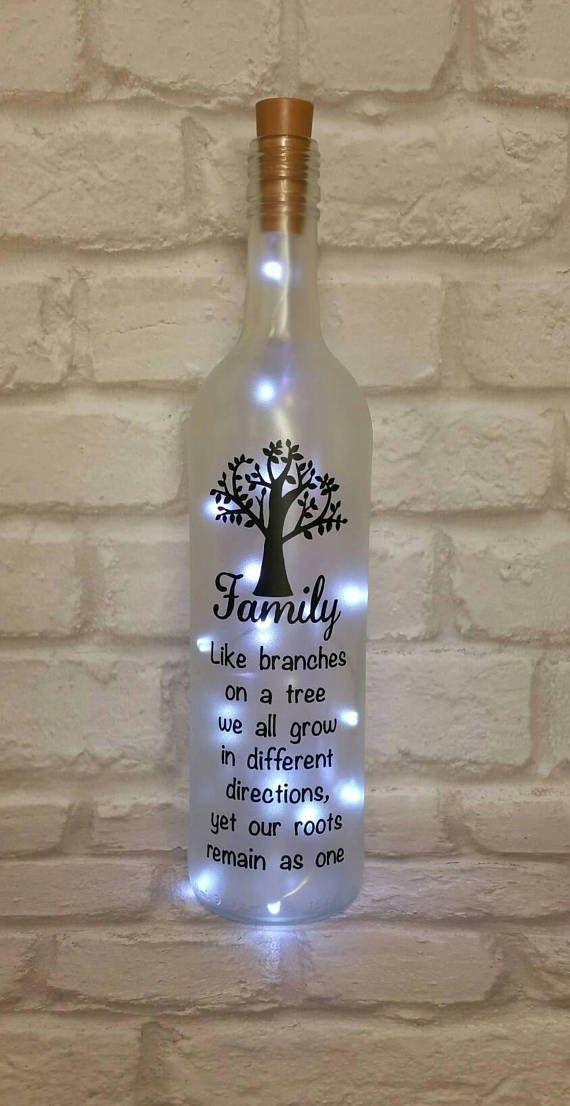 This beautiful light up wine bottle would make a lovely gift for someone special or just as a keepsake. The bottle has a frosted look and the quote is made using high quality black vinyl. The quote reads Family Like branches on a tree we all grow in different directions, yet our