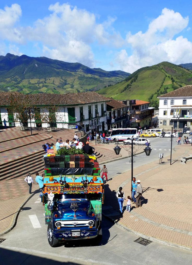 Colourful Antioquia! Explore this beautiful department of Colombia on a ride through the lush mountains. If you do it like the locals, just hop on the chiva and enjoy the landscape! #colombia #travelandmakeadifference #chiva #antioquia