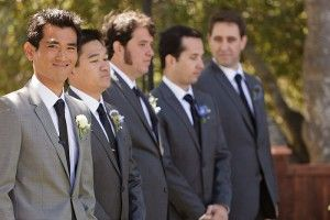 This is how I see it for my wedding... Charcoal grey suits for the men, and a different shade of grey for the groom.
