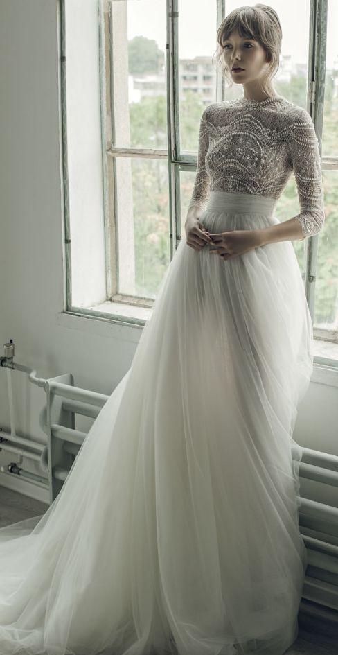 Uniquely glamorous high neck quarter length sleeve wedding dress; Featured Dress: Ersa Atelier