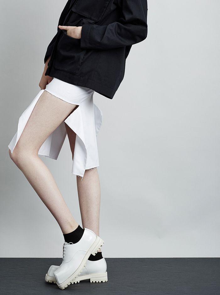 White skirt with open sides & unfinished hem; contemporary fashion details // Yulia Yefimtchuk