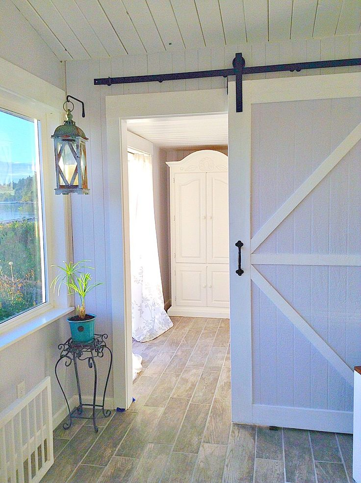 Beautiful finished sliding barn door-pic sent to us from one of our wonderful etsy customers!  We made the hardware-not the door.  The door was built by S & S Construction, Langley, Washington.  Get your sliding barn door hardware here: https://www.etsy.com/shop/InnovativeMetalcraft  We have the best prices and best quality.