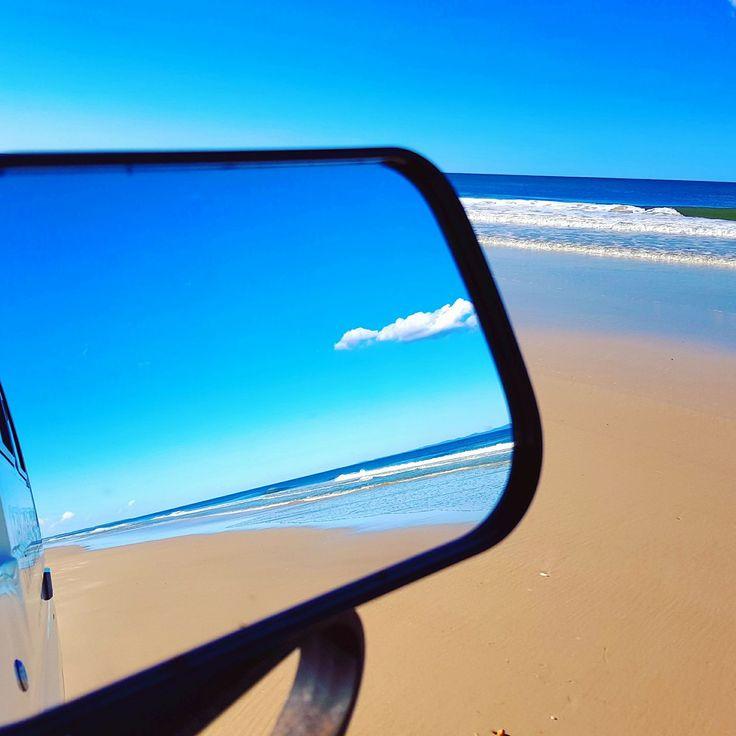 Driving along Bribie beach