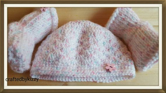 Check out this item in my Etsy shop https://www.etsy.com/uk/listing/246132765/baby-girl-hat-and-booties-tunisian