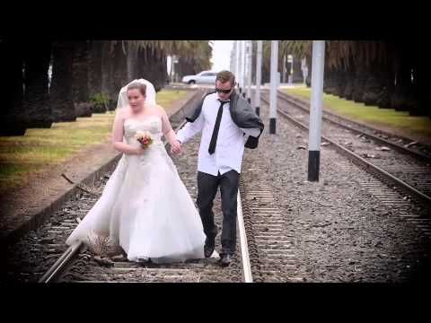 Funny Wedding Reception Entrance- video of the couple swimming across the bay, hitch hiking, and riding around in a golf cart to get to the reception.