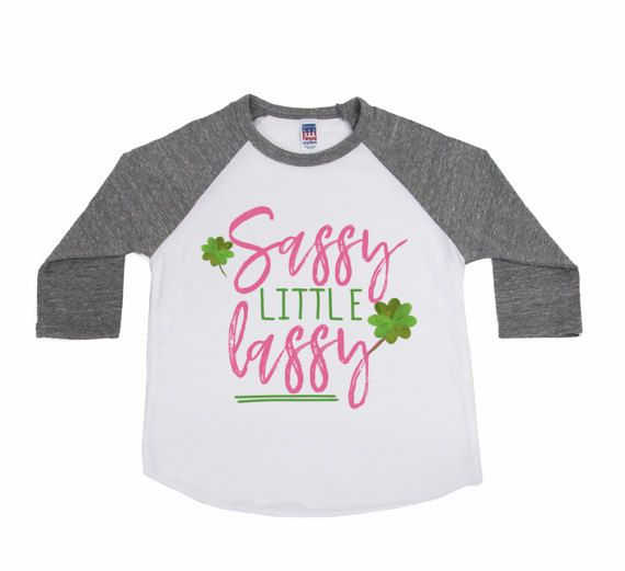 Sassy little Lassy perfect for the little Irish or non-Irish child in your life! ►Pairs perfectly with our hair accessories or leg warmers - https://www.etsy.com/shop/VazzieTees?section_id=17277950&ref=shopsection_leftnav_8 ________________________________________________________ ►PRODUCT DESCRIPTION Design is available on our Unisex Raglan 3/4 Sleeve Tees Sleeve Color: Heather Grey or Kelly Green Sizes 3-6m, 6-12m, 12-18m, 18-24m, 2, 4, 6, 8, 10 &...