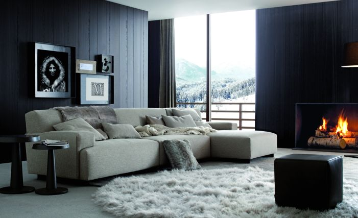 Poliform|Varenna_winter home_ Soho sofa in removable fabric, Anna coffee tables in spessart oak with top in hide. Pouf Play in leather.